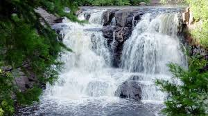 peaceful nature scene of a waterfall in