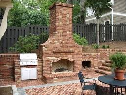 outdoor fireplace with built in grill