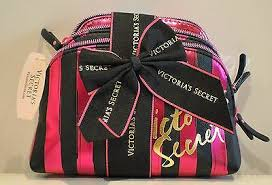 pink and black stripe cosmetic bag