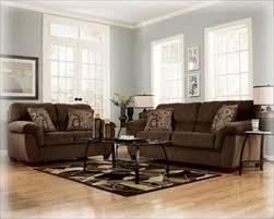 brown couch with pale blue grayish