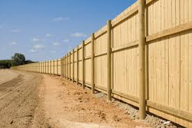 Rural Privacy Fence With Treated Round Post And Three Horizontal Rails Fence Types Of Fences Wood Fence Privacy Fence