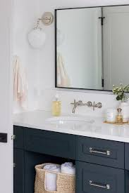 washstand with black metal frame mirror