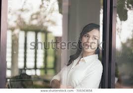 glass window asian girl stock photo