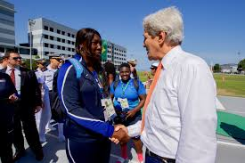 File:Secretary Kerry shakes hands with U.S. Women's Track and Field coach  Connie Price-Smith at the Brazilian Naval Academy in Rio de Janeiro  (28172686273).jpg - Wikimedia Commons