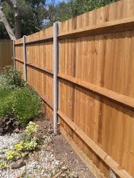 Close Boarded Fence With Concrete Posts And Timber Gravel Boards Wood Fence Design Steel Fence Posts Wood Fence