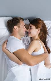 young couple hugging on the bed in