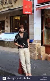 Adam Rogers, holding Nikon F model camera, posing at Gerard street Stock  Photo - Alamy