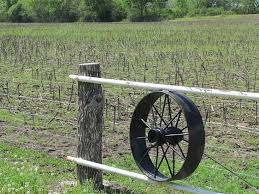 Old Vintage Antique Metal Wagon Wheel Used On A Fence With Post And Pipe By James Sigle Photo Stock Snapwire