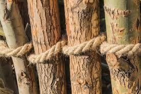 Rope Tied In A Knot Around Wooden Poles Fence Posts Closeup Premium Photo