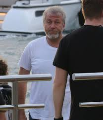 Chelsea owner Roman Abramovich looks glum as he arrives at exotic island on  £1.2billion yacht before boarding helicopter