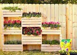 Diy Kids Water Table By Inspirationthief Made For About 11 With Scrap Wood And A Plastic Cement Mixing Tub Vertical Planter Fence Planters Garden Yard Ideas