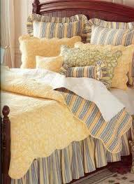 yellow toile quilt and bedding