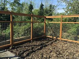 New Lawn Irrigation Drainage And Deer Proof Hog Wire Fencing Farmhouse Seattle By Erin Landscaping Masonry