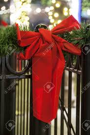 Red Ribbon Tied To Black Wrought Iron Fence Trimmed With Green Stock Photo Picture And Royalty Free Image Image 34702093