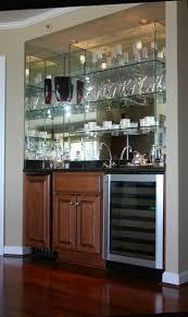 closet into custom mirror and glass bar