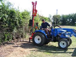 Fencing Field Care Fencing Field Care Compact Tractor With Hydraulic Post Driver Erecting Posts For Fencing