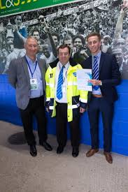 CENTRAL MIDFIELDER, ADAM MAY PRESENTS CERTIFICATES TO STEWARDS — QTSD