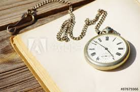old pocket watch and the open book with
