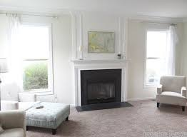 wood trim above fireplace mantle