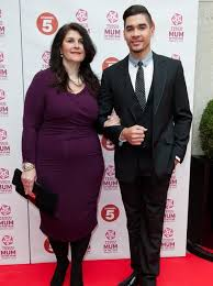 Louis Smith could NOT look happier to have his mum on his arm ...
