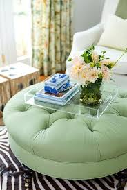 green tufted ottoman with caster legs