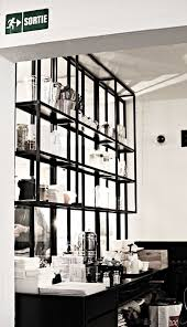 bar shelving idea with antiqued mirror