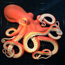 rustic wall art octopus on world map