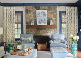 rustic stone fireplace with light blue