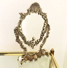 silver plated ornate vanity mirror