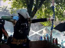 Hong Kong campus protesters fire arrows as unrest spreads across ...