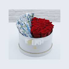 box of red roses with bounty chocolate