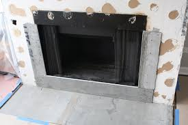 adding marble subway tile to fireplace