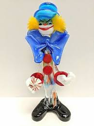 vintage murano glass clown holding a