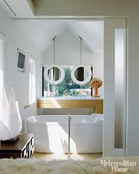 hanging mirrors in front of windows