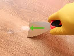 remove adhesive from a hardwood floor