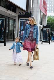 Matching mommy-and-me outfits: Alexis Bryan Morgan and Ada Morgan in denim  jackets and floral dresses. - All The Pretty Birds