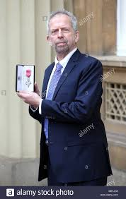 Adrian Jackson with his MBE medal following an investiture ceremony Stock  Photo - Alamy
