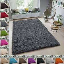large small round fluffy gy rug