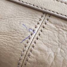ballpoint ink stains from leather purses