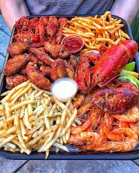 seafood chicken wings and fries ...