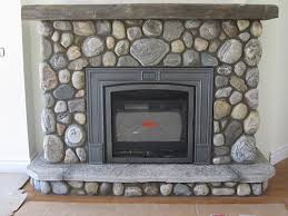 valor gas fireplace with river stone