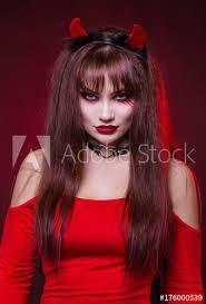 a beautiful y woman in a devil