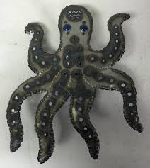 octopus wall sconce recycled tin for