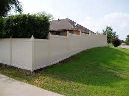 At Future Outdoors We Fabricate Our Vinyl Fences And Install Custom Fences Like This One It Follows The Gr Vinyl Fence Vinyl Privacy Fence Vinyl Fence Panels
