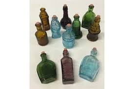 miniature coloured glass bottles