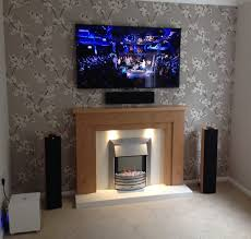 50 led tv above fireplace techtone