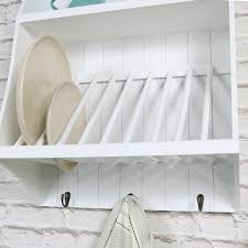 white wall mounted wooden plate rack