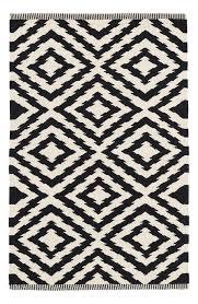 clover geometric black woven cotton rug