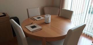 large round oak veneer dining table 4