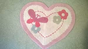 pink heart shaped rug with erfly